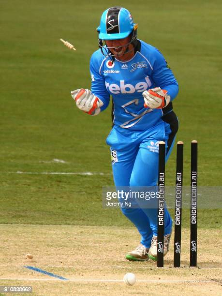 Wicketkeeper Tegan McPharlin of the Strikers celebrates the wicket of Ellyse Perry of the Sixers during the Women's Big Bash League match between the...