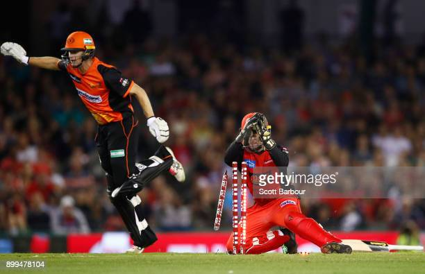 Wicketkeeper Tim Ludeman of the Renegades runs out Adam Voges of the Scorchers during the Big Bash League match between the Melbourne Renegades and...