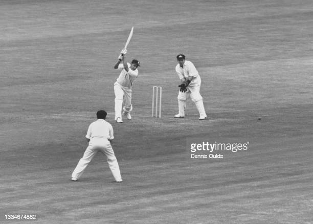 Wicketkeeper Wally Grout looks on from behind the stumps as Raman Subba Row of England plays an on drive shot off the bowling of Bob Simpson of the...