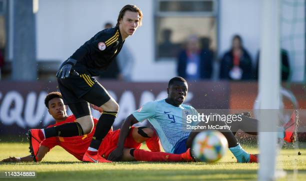 Wicklow Ireland 12 May 2019 Brian Brobbey of Netherlands in action against Belgium goalkeeper Maarten Vandevoordt and Killian Sardella of Belgium...
