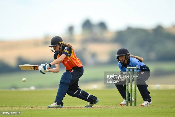 Wicklow Ireland 3 August 2020 Alana Dalzell of Scorchers plays a shot watched by Typhoons wicketkeeper Amy Hunter during the Women's Super Series...