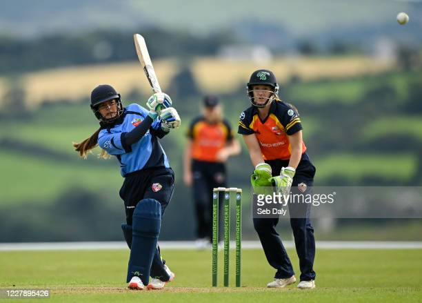 Wicklow Ireland 3 August 2020 Amy Hunter of Typhoons plays a shot to score a boundary watched by Scorchers wicketkeeper Shauna Kavanagh during the...