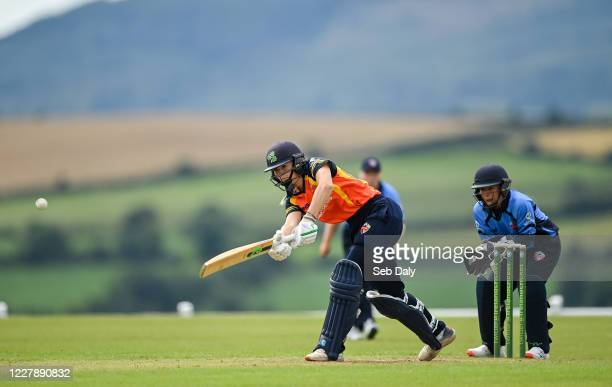 Wicklow Ireland 3 August 2020 Gaby Lewis of Scorchers plays a shot watched by Typhoons wicketkeeper Amy Hunter during the Women's Super Series match...
