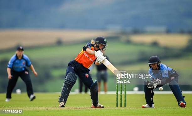 Wicklow Ireland 3 August 2020 Leah Paul of Scorchers plays a shot watched by Typhoons wicketkeeper Amy Hunter during the Women's Super Series match...