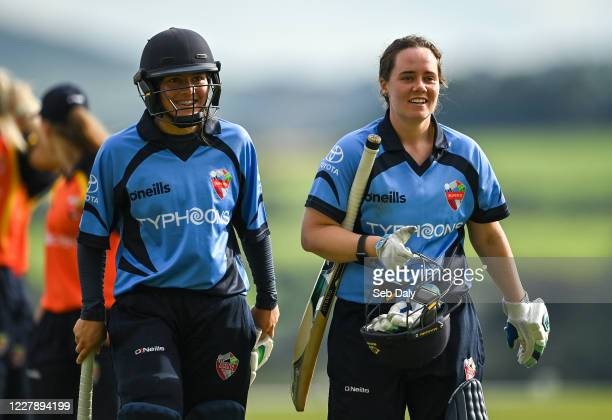 Wicklow Ireland 3 August 2020 Typhoons batters Amy Hunter left and Laura Delany leave the field following their side's victory during the Women's...