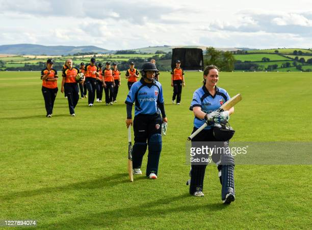 Wicklow Ireland 3 August 2020 Typhoons batters Laura Delany right and Amy Hunter leave the field following their side's victory during the Women's...
