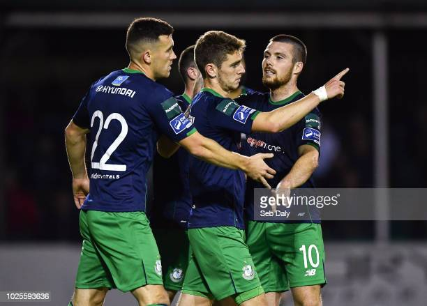 Wicklow Ireland 31 August 2018 Dylan Watts of Shsmrock Rovers centre is congratulated by teammates Aaron Greene left and Brandon Miele right after...