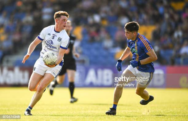 Wicklow Ireland 9 June 2018 Ciaran Brady of Cavan in action against Saoirse Kearon of Wicklow during the GAA Football AllIreland Senior Championship...