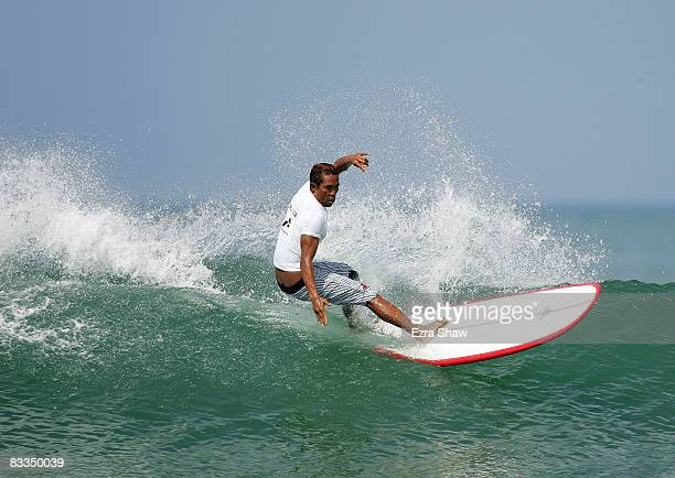 Widana Wayan of Indonesia competes in the men's longboard surfing competition on day three of the 2008 Asian Beach Games at Kuta Beach on October 20...