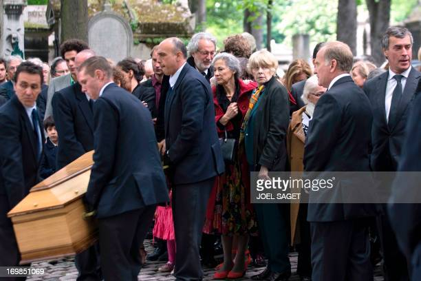 Widdow of late Guy Carcassonne Claire Bretecher stands on June 3 2013 at the Montmartre cemetery in Paris during the funeral of the French University...