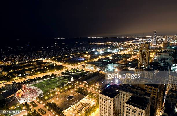 wide aerial view of chicago lakefront at night - cloud gate stock photos and pictures