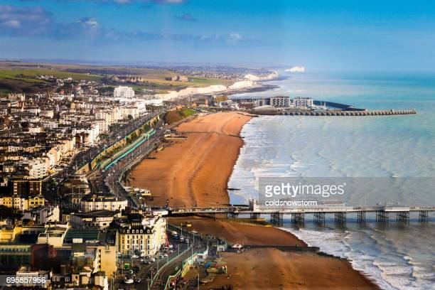 Wide angle aerial view of Brighton beach and coastline, Brighton, UK