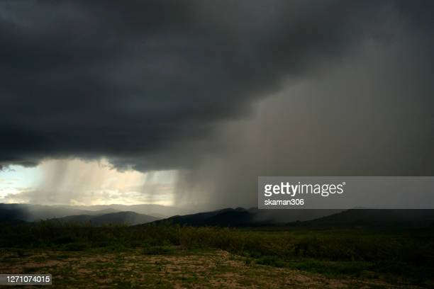 wide angle bad weather landscape of heavy raining cover the mountain - dramatic landscape stock pictures, royalty-free photos & images