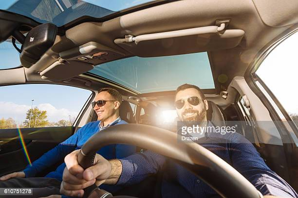wide angle image of two adults in car - wide angle stock pictures, royalty-free photos & images