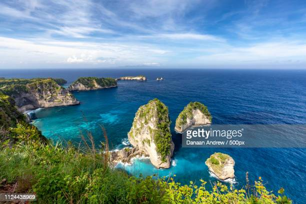 wide angle nusa penida landscape - regency style stock photos and pictures