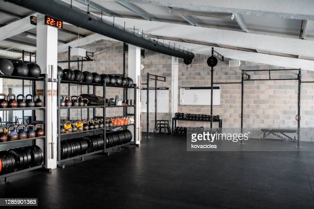 wide angle of an empty gym - health club stock pictures, royalty-free photos & images