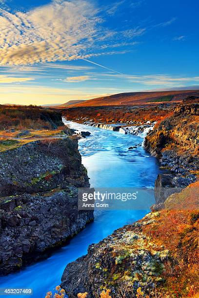 Wide angle of Hraunfossar flowing into canyon