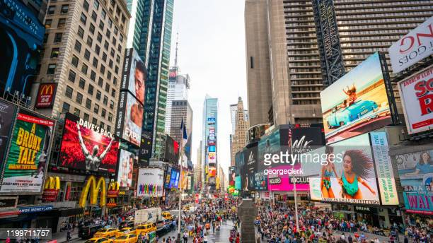 wide angle on times square, new york city - times square manhattan stock pictures, royalty-free photos & images