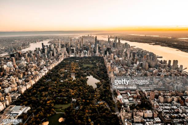 wide angle shot of a central park, new york, taken from a chopper at golden hour - lower manhattan stock pictures, royalty-free photos & images