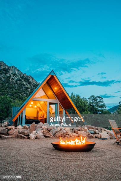 wide angle shot of a modern tiny home with a cast iron firepit in western colorado at dusk - hotel stock pictures, royalty-free photos & images