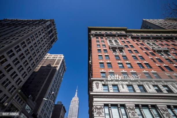 Wide angle shot of buildings near Madison Square Park with Empire State Building in distance