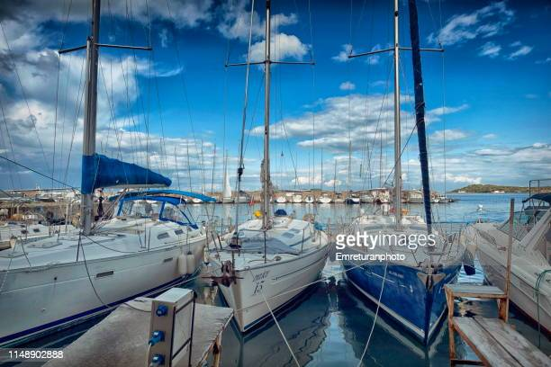 wide angle view of anchored sailboats in urla marina in izmir. - emreturanphoto stock pictures, royalty-free photos & images