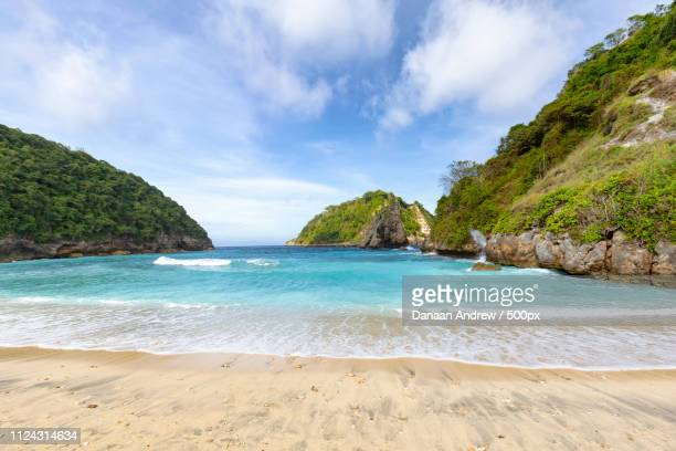 wide angle view of atuh beach - regency style stock photos and pictures