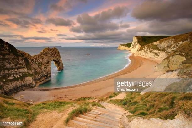 wide angle view of durdle door, dorset, england, uk - jurassic coast stock pictures, royalty-free photos & images