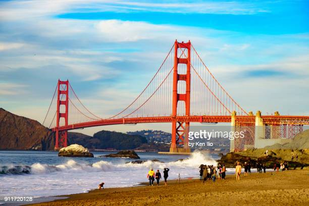 wide angle view of golden gate bridge from baker beach - ken ilio stock pictures, royalty-free photos & images