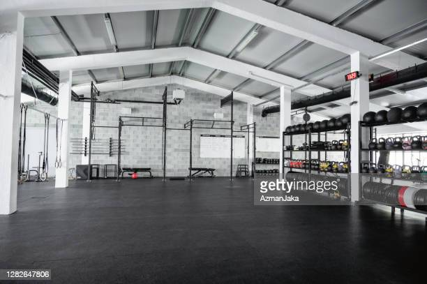wide angle view of modern open plan gym - health club stock pictures, royalty-free photos & images