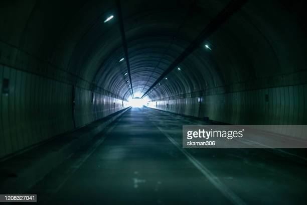 wide angle view of open highways road underground tunnel with lighting - exit sign stock pictures, royalty-free photos & images