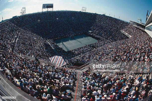 Wide angle view of spectators watching competition inside the Louis Armstrong Stadium during the 1979 US Open tennis tournament at the USTA National...