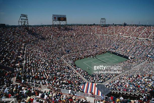 Wide angle view of spectators watching competition inside the Louis Armstrong Stadium during the 1980 US Open tennis tournament at the USTA National...