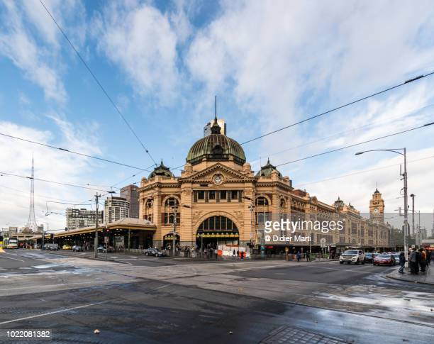 wide angle view of the famous flinders street railway station in the heart of melbourne in australia second largest city - wide angle stock pictures, royalty-free photos & images