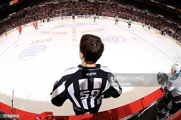 A wide angle view of the ice from behind linesman Steve Barton during the NHL game between the Detroit Red Wings and the San Jose Sharks at Joe Louis...