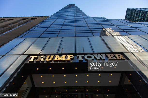 """Wide angle view of the main entrance with the incription """"Trump Tower"""" in New York city in the USA. The 58-floor skyscraper at Fifth Avenue..."""