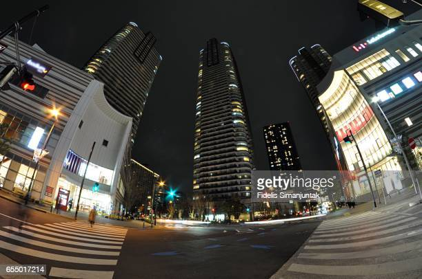 Wide angle view of Tokyo cityscape and intersection at night