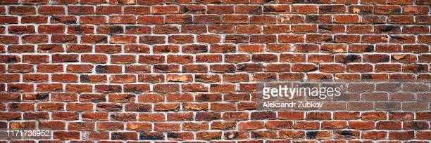 wide background in the form of a red brick wall. - wide stock pictures, royalty-free photos & images