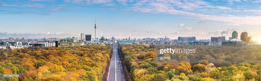 wide Berlin skyline over autumn colored  Tiergarten : Stock Photo