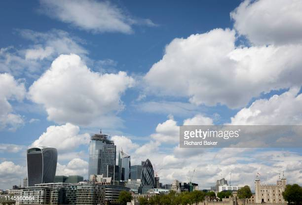 A wide cityscape of the the Tower of London and the City of London the capital's financial district on 10th May 2019 in London England