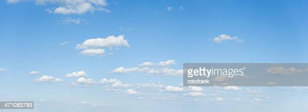 wide cloudscape on a clear blue sky - clear sky stock pictures, royalty-free photos & images