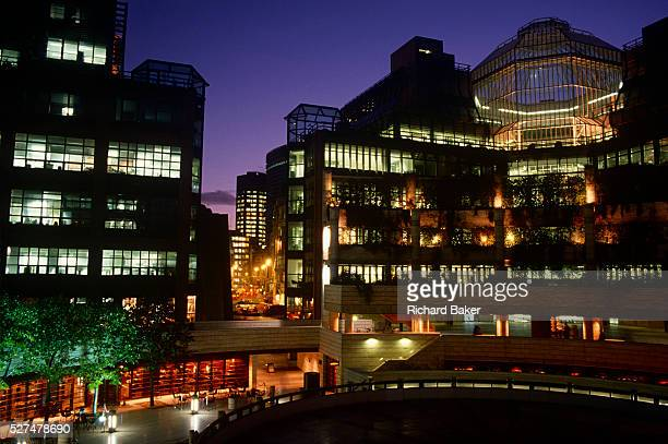 A wide dusk landscape of the development in the City of London known as Broadgate is a vast estate of corporate buildings developed in the Thatcher...