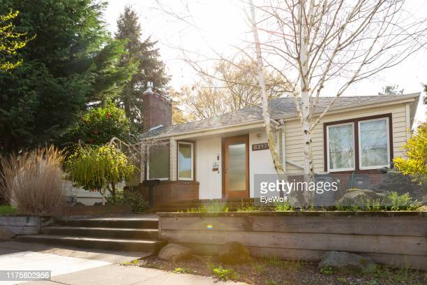 wide exterior shot of a 1940 style bungalow style house in portland oregon. - community building stock pictures, royalty-free photos & images