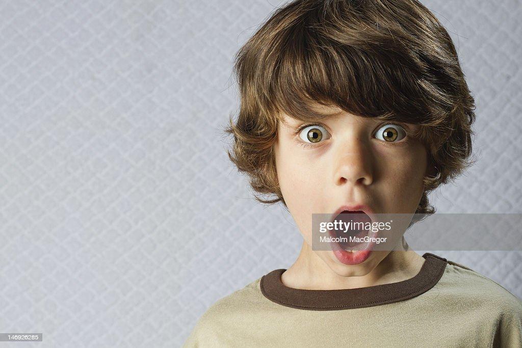 Wide eyed boy : Stock Photo
