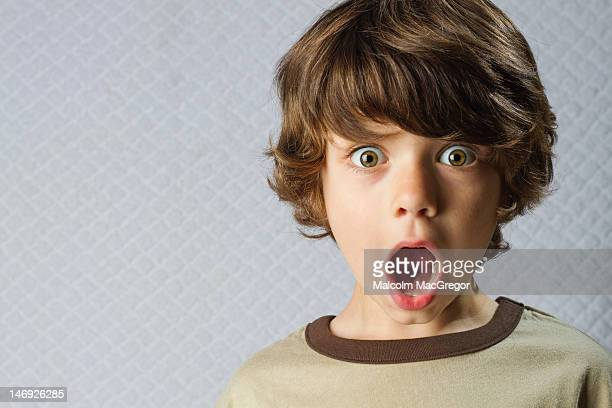wide eyed boy - innocence stock pictures, royalty-free photos & images
