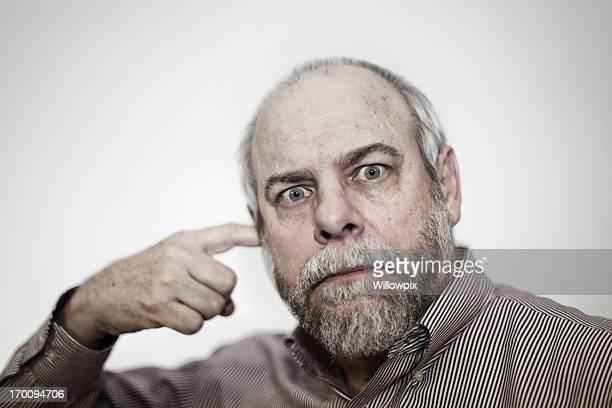wide eyed man pointing at ear - fingers in ears stock pictures, royalty-free photos & images