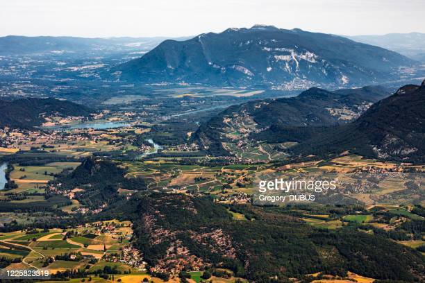 wide french panorama in summer rolling landscape of south bugey mountains border between ain and savoie department - grand colombier ain stock pictures, royalty-free photos & images