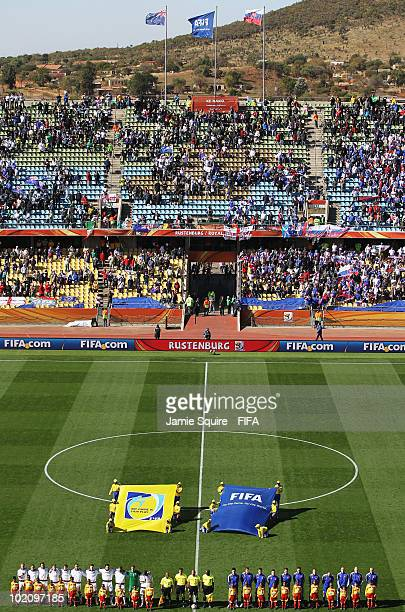 A wide general view as the teams line up for their national anthems during the 2010 FIFA World Cup South Africa Group F match between New Zealand and...