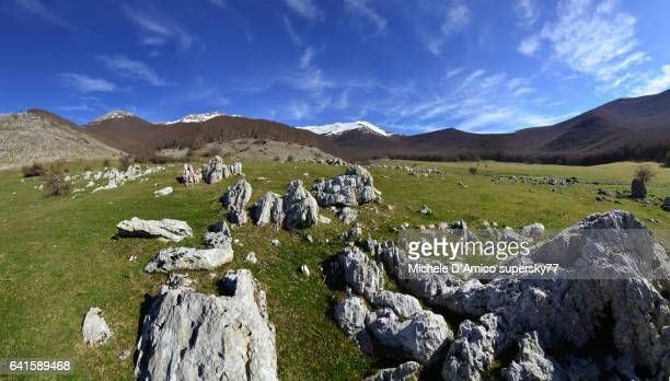 wide grassy plateaus in the appennines. - limestone pavement stock pictures, royalty-free photos & images