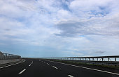 wide highway without cars blue sky